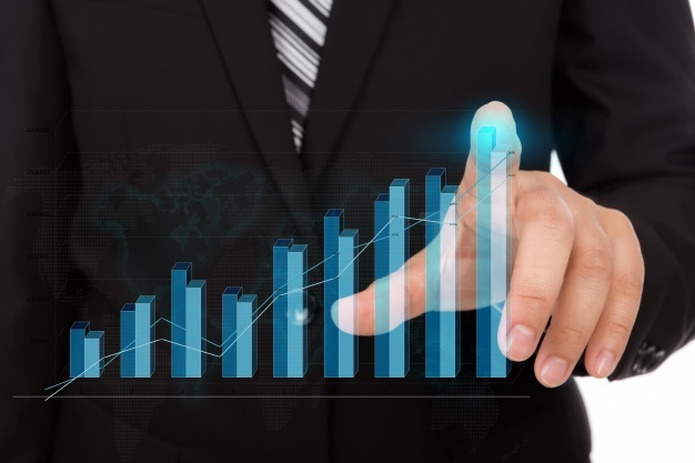 businessman-touching-the-tip-of-a-bar-chart_1232-898